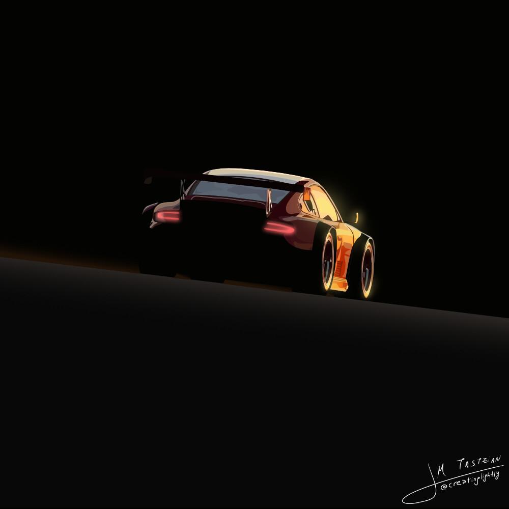 Racing Porsche 911 at sunset