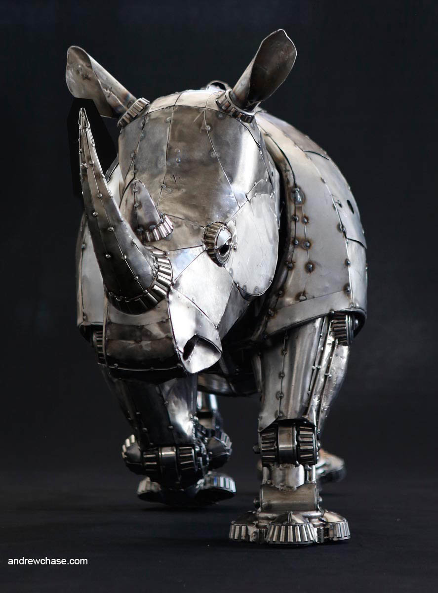 Andrew chase mechanical recycled metal articulated rhino trotting 1