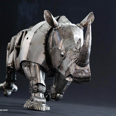 Andrew chase mechanical recycled metal articulated rhino trotting 2