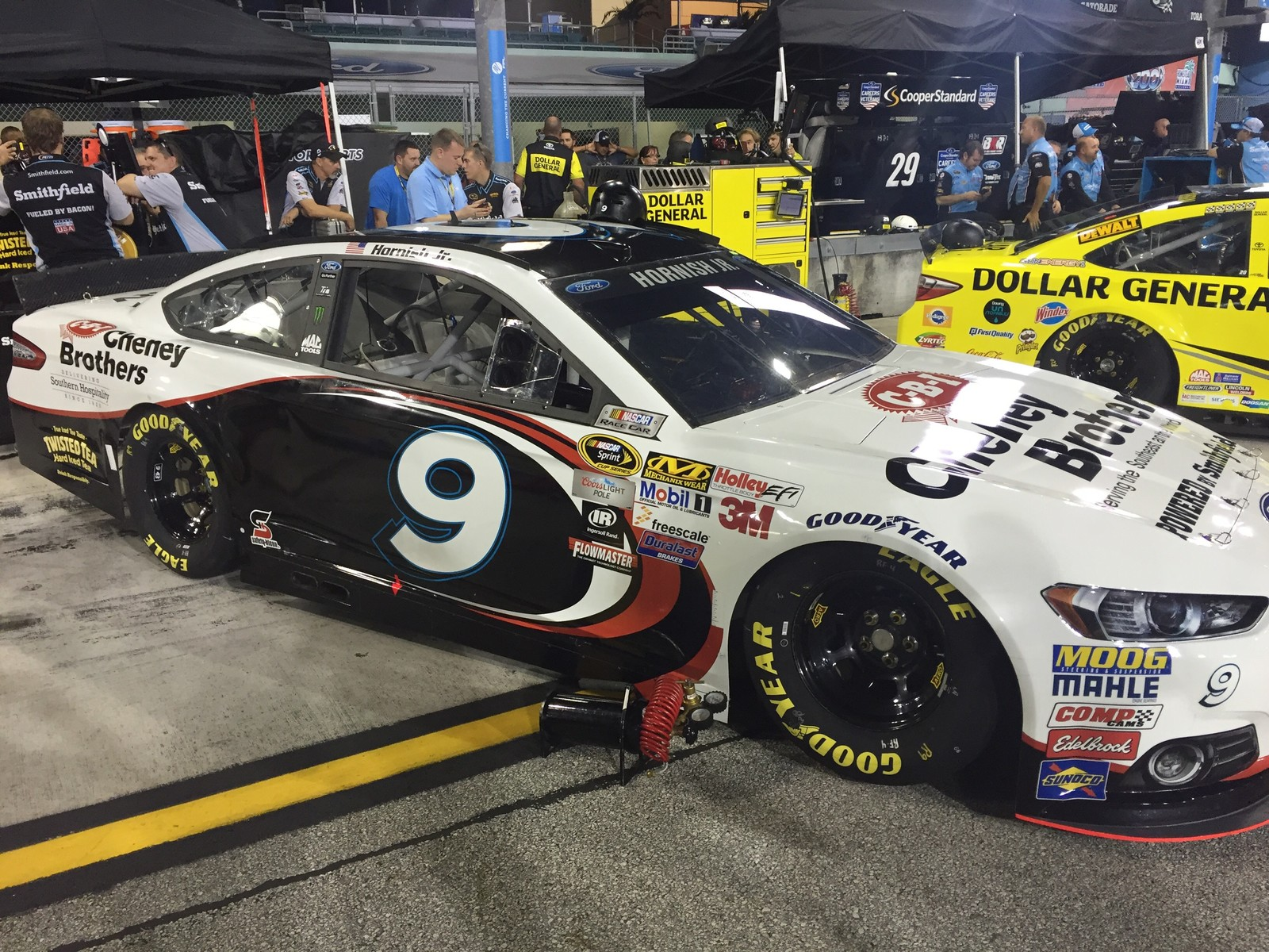 The #9 Cheney Brothers Ford Fusion and crew awaiting qualifying at Homestead-Miami Speedway on November 20th, 2015 (Photo credit: Roy Gangdal of BK Racing)