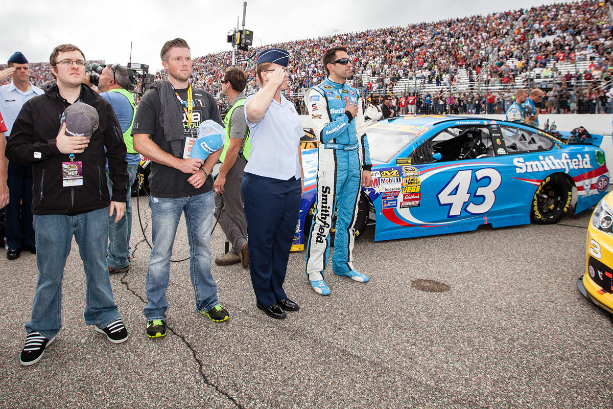 With Aric Almirola and Smithfield guests during the National Anthem at the Fall New Hampshire Motor Speedway event.