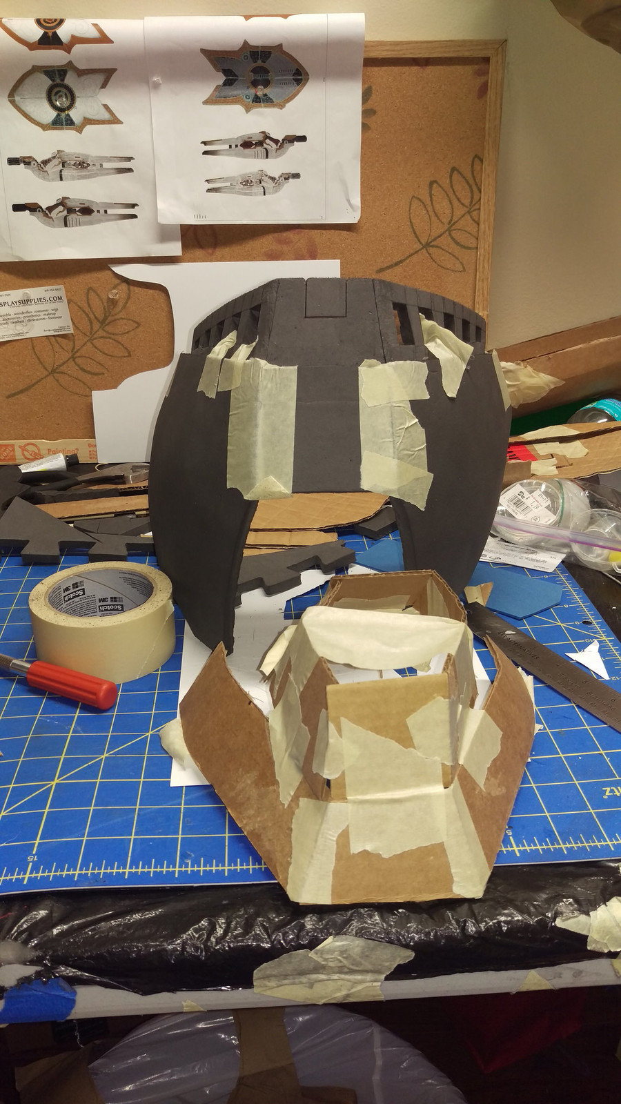 Blocking out the chest piece with cardboard, then foaming it.