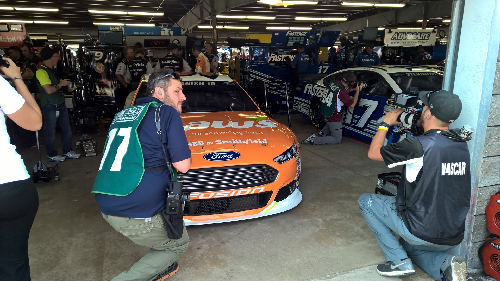 The #9 Shaw's Supermarkets Ford Fusion and NASCAR Sprint Cup Series driver Sam Hornish Jr. being filmed before a practice session from the garage at New Hampshire Motor Speedway. July 17th, 2015.