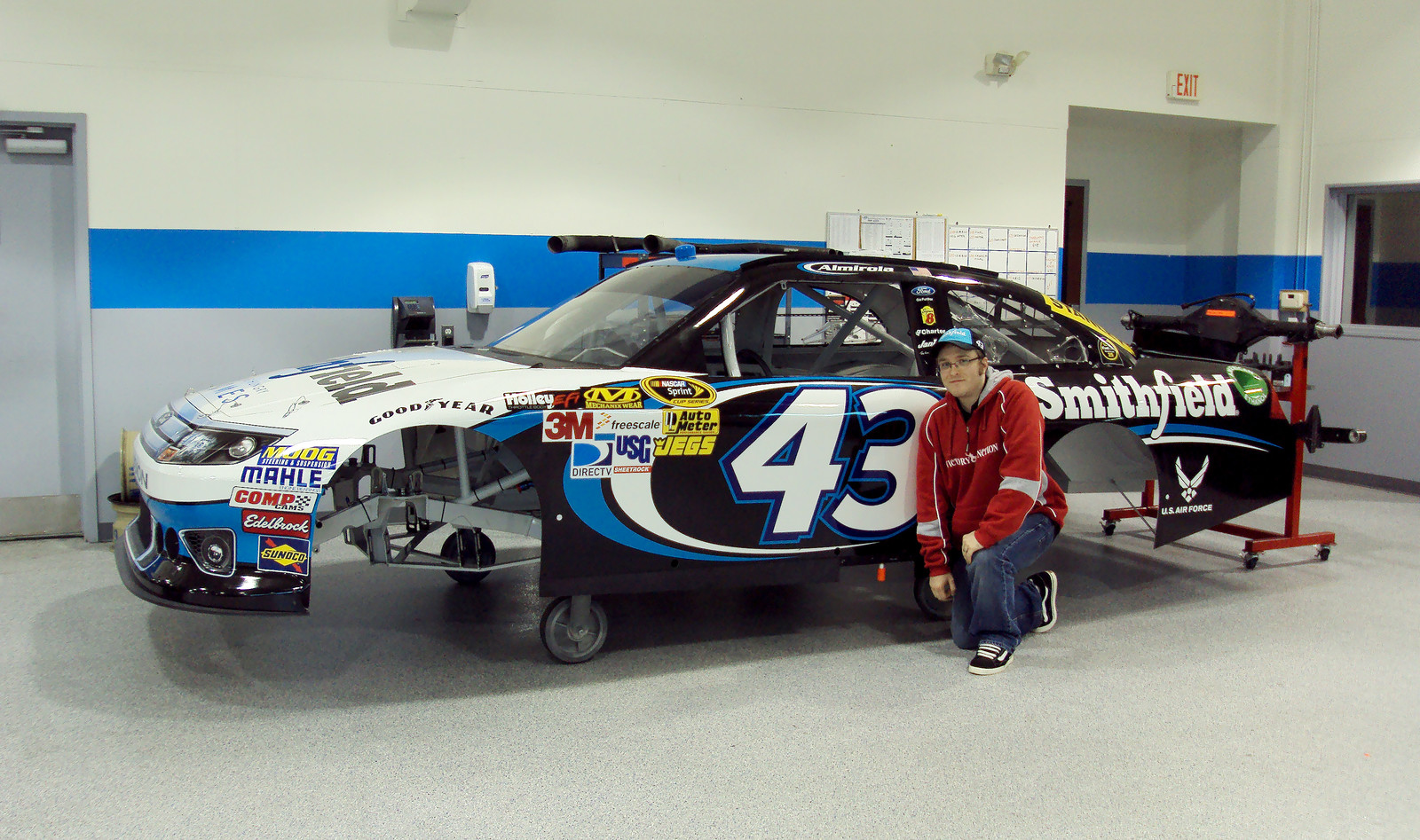 Posing with a newly wrapped 2012 #43 Smithfield car at the Richard Petty Motorsports race shop in Concord, North Carolina