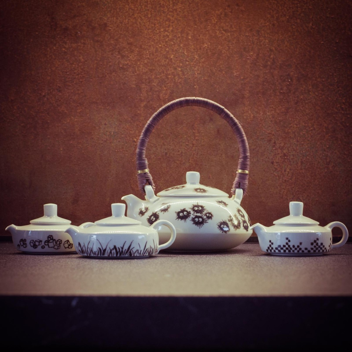 little painted porcelain teapots