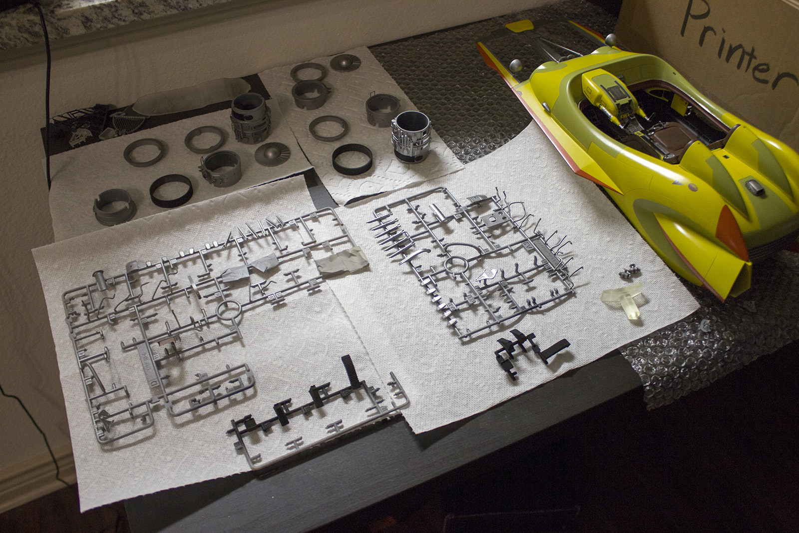 The main body is finished and the parts for the engines are clean and laid out to be assembled.