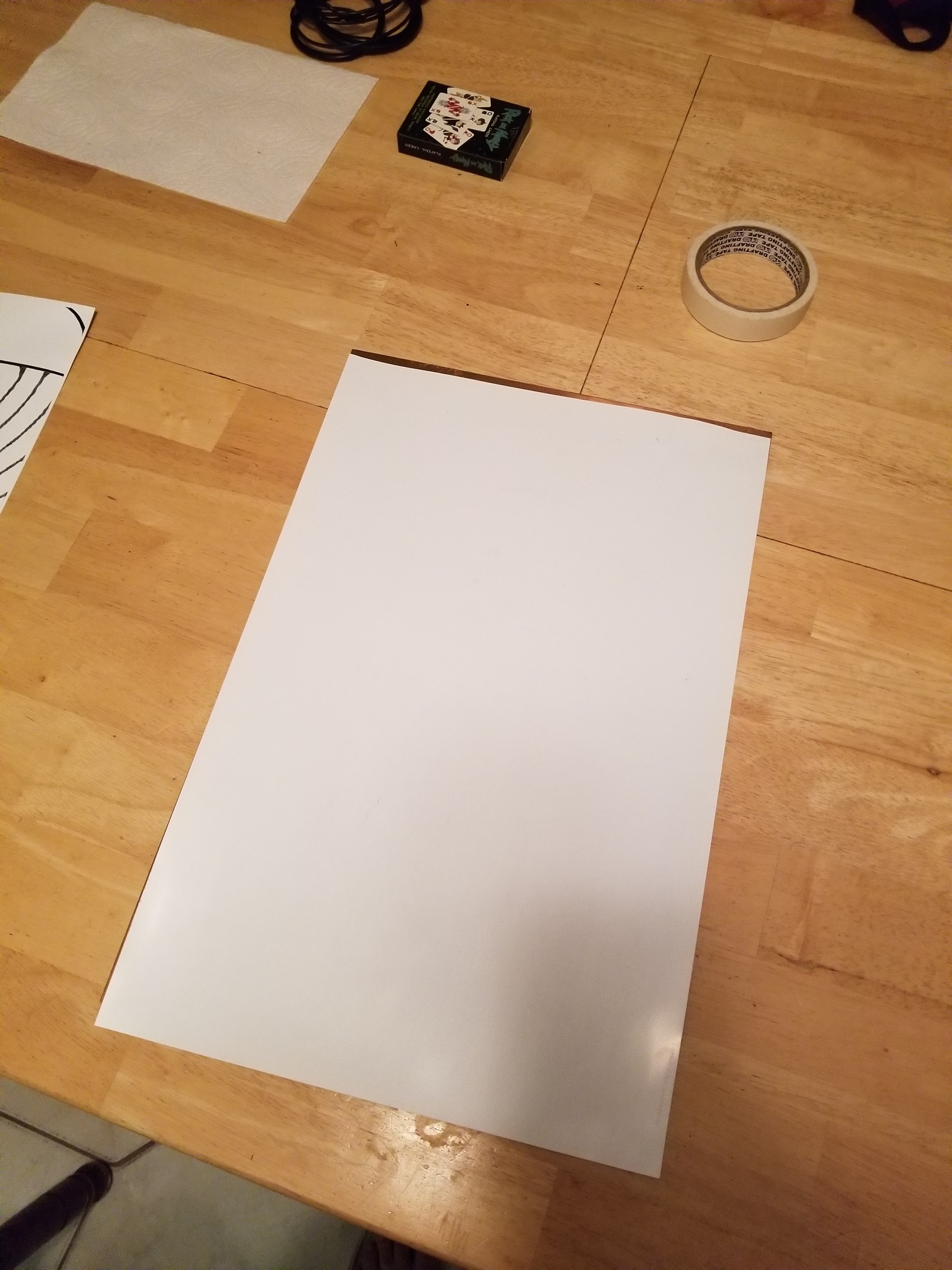 Placement of mylar onto copper plate and tape it to the surface.