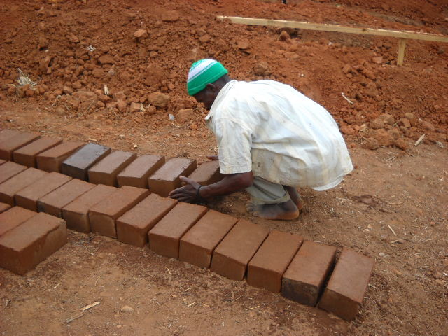 Pressed bricks or earth, cement, and water left to cure in the sun.