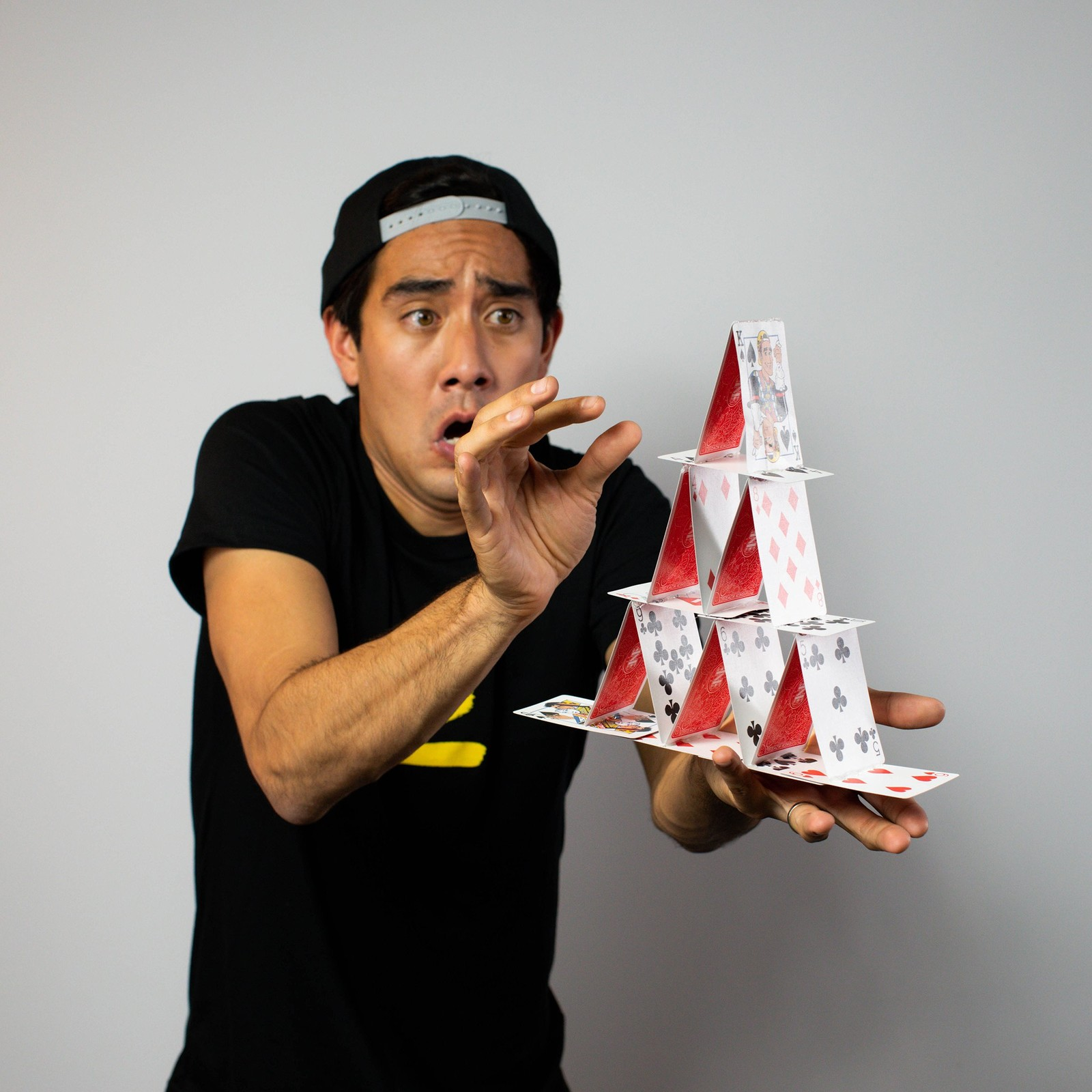Zach King playing with his themed card deck