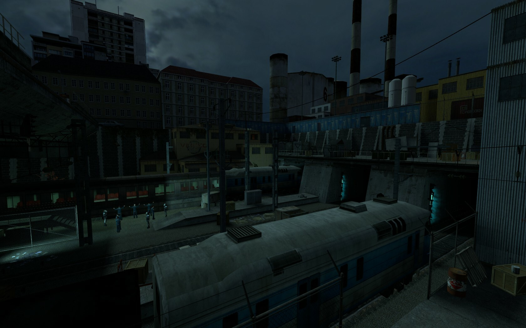 The main focus of this train yard (the npcs) have been highlighted with a light shining upon them as the yard is busy and there is a lot of other things going on.