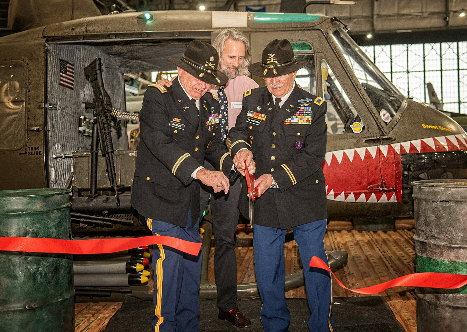 "Lt. Colonel Ken Overturf and Colonel Bill McPherson open the ""Sweet Souix"" Huey exhibit at the Wings Over the Rockies Museum with Curator Matthew Burchette"