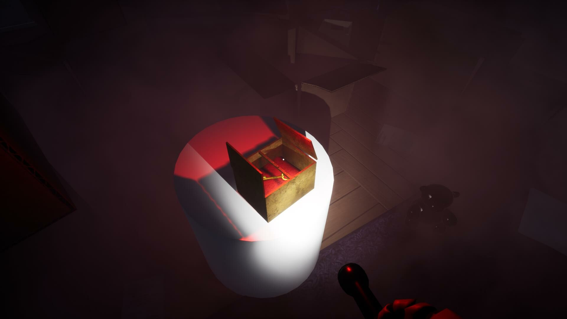 The player obtains the final key in a golden box surrounded by toys
