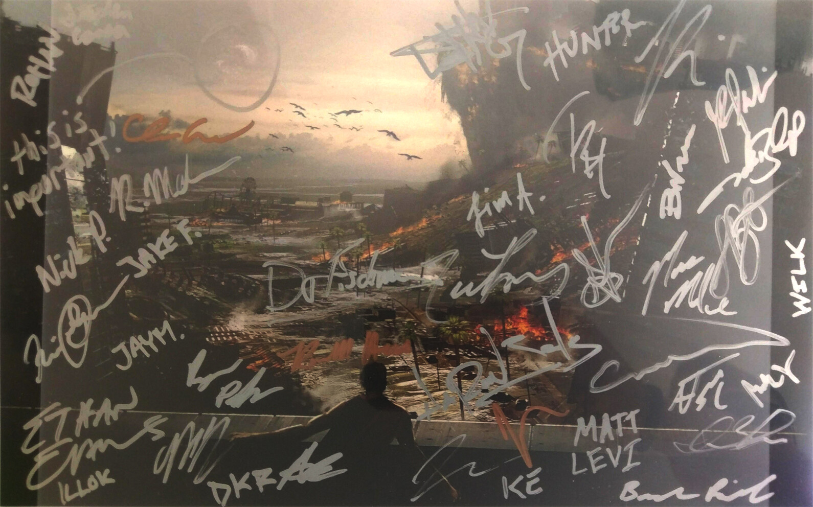 This is a fan's photo that won a contest for Lawbreakers and recieved a print of my concept, signed by several employees at Boss Key Productions! Pretty cool!