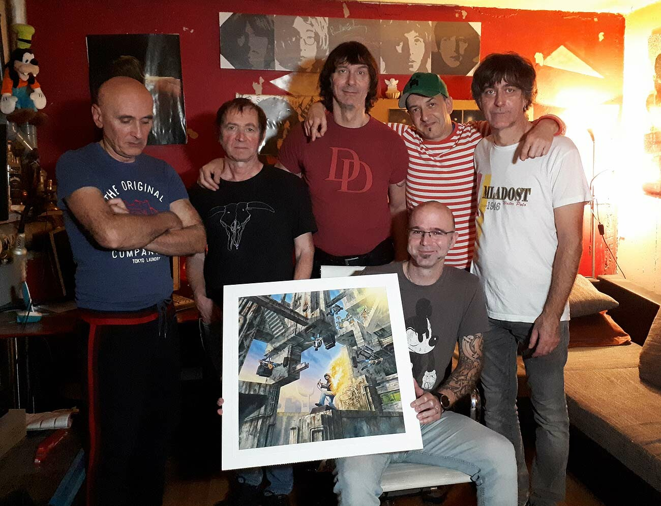 Psihomodo Pop band with the artist and the original Digitalno Nebo cover artwork. Photo taken in the band studio, on 13 November 2019