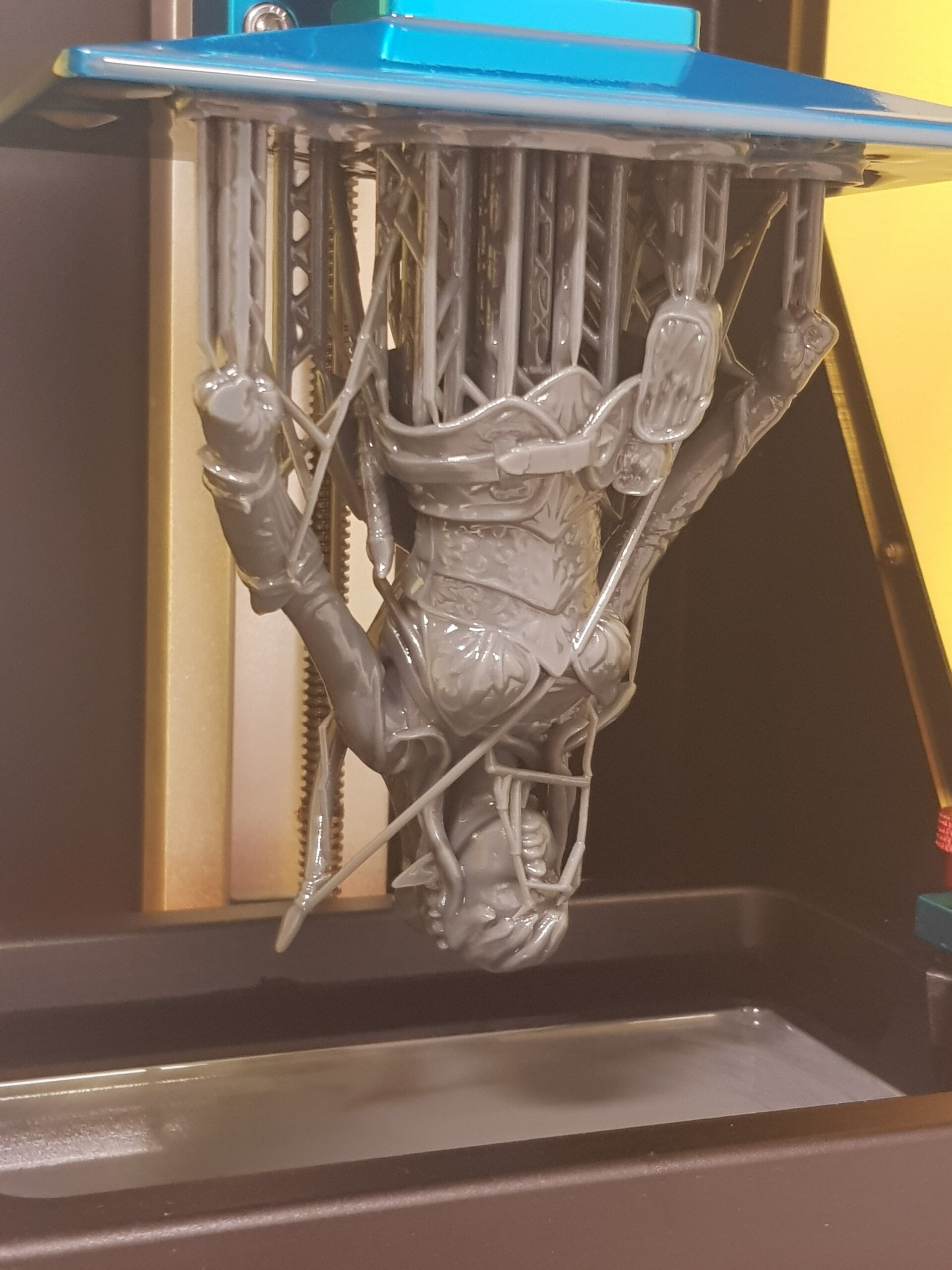The top part of the big-size print, still attached to the printer bed