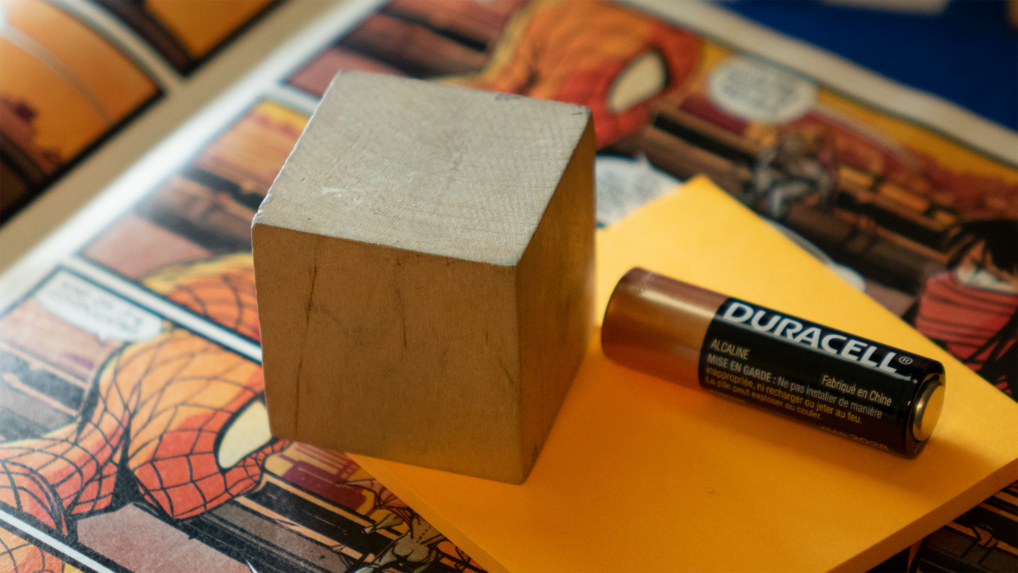 Wood cube, used to match perspective.