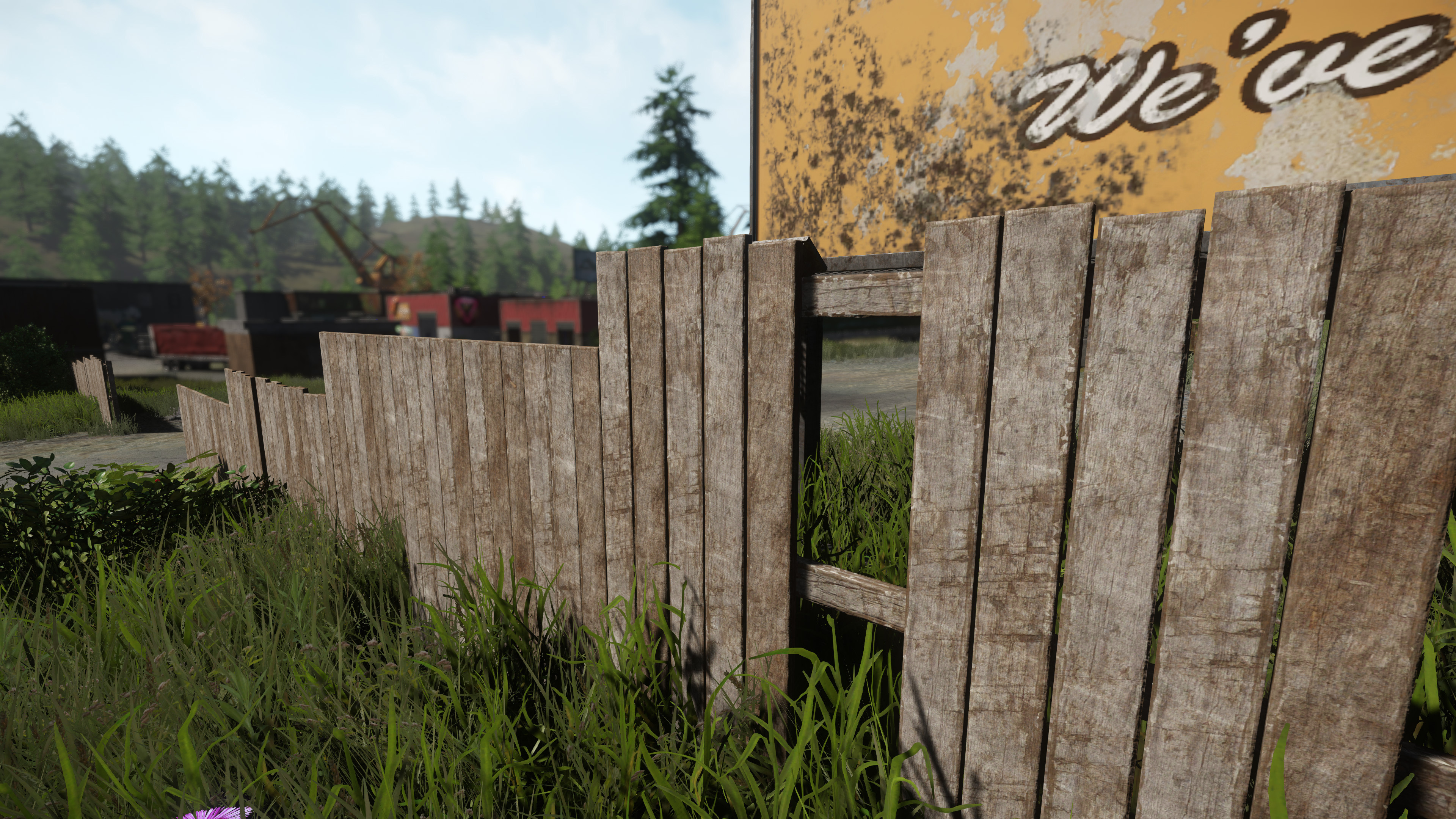 High Wooden Fence to section off the junkyard area
