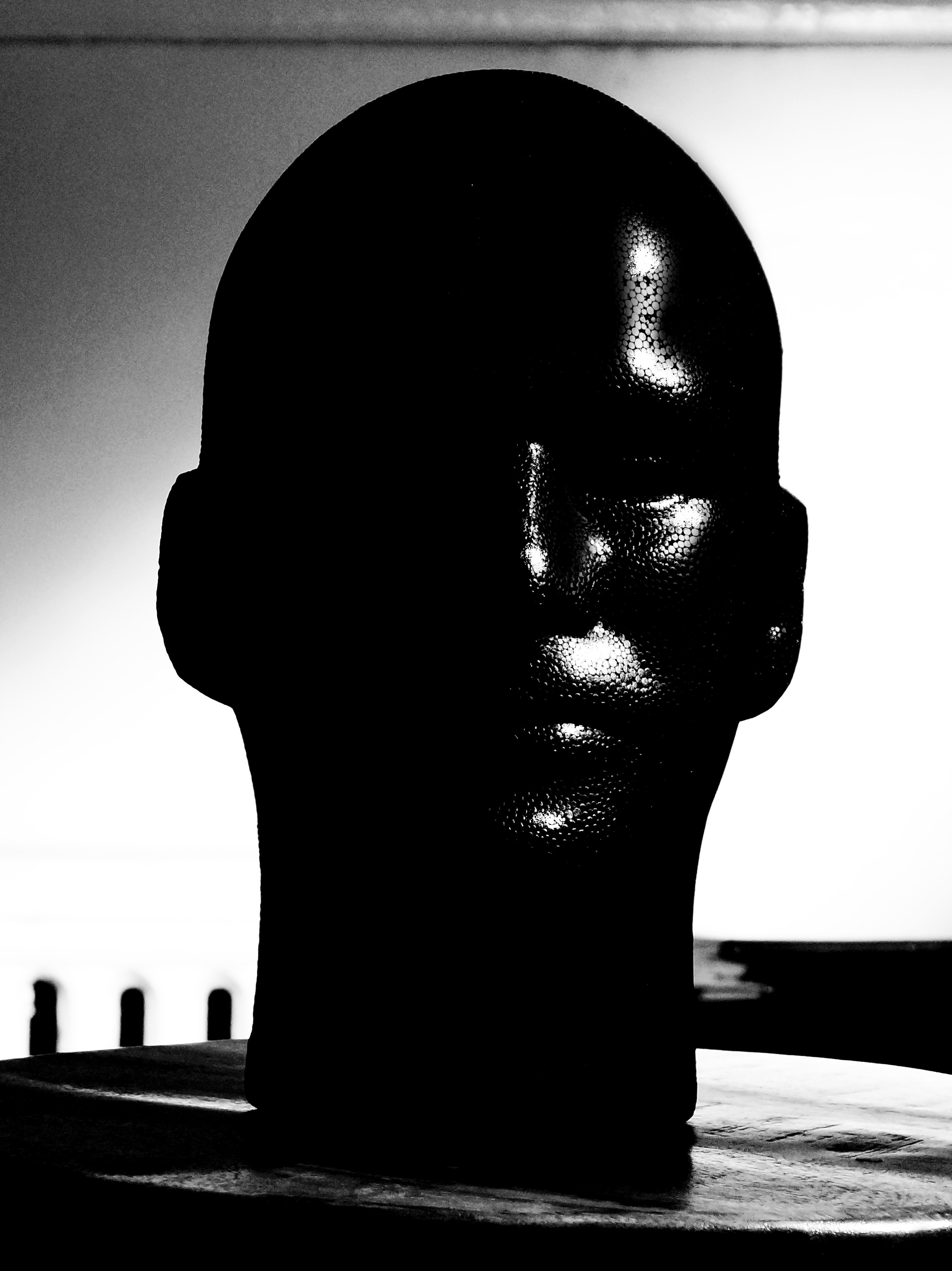 Photograph of a the manikin head demonstrating the  placement and properties of  of the highlight. Created by Vince Mancuso