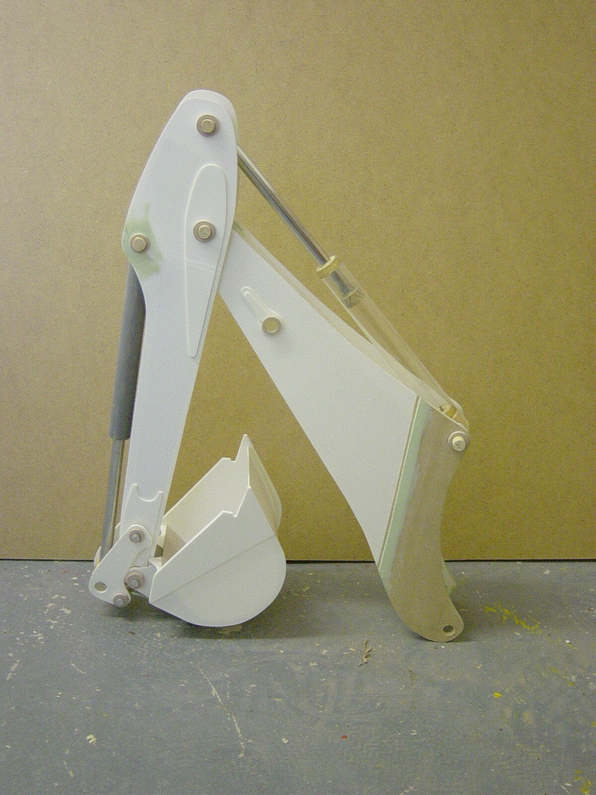 The rear arm feature was put together using styrene, mdf, kemi wood and filler.