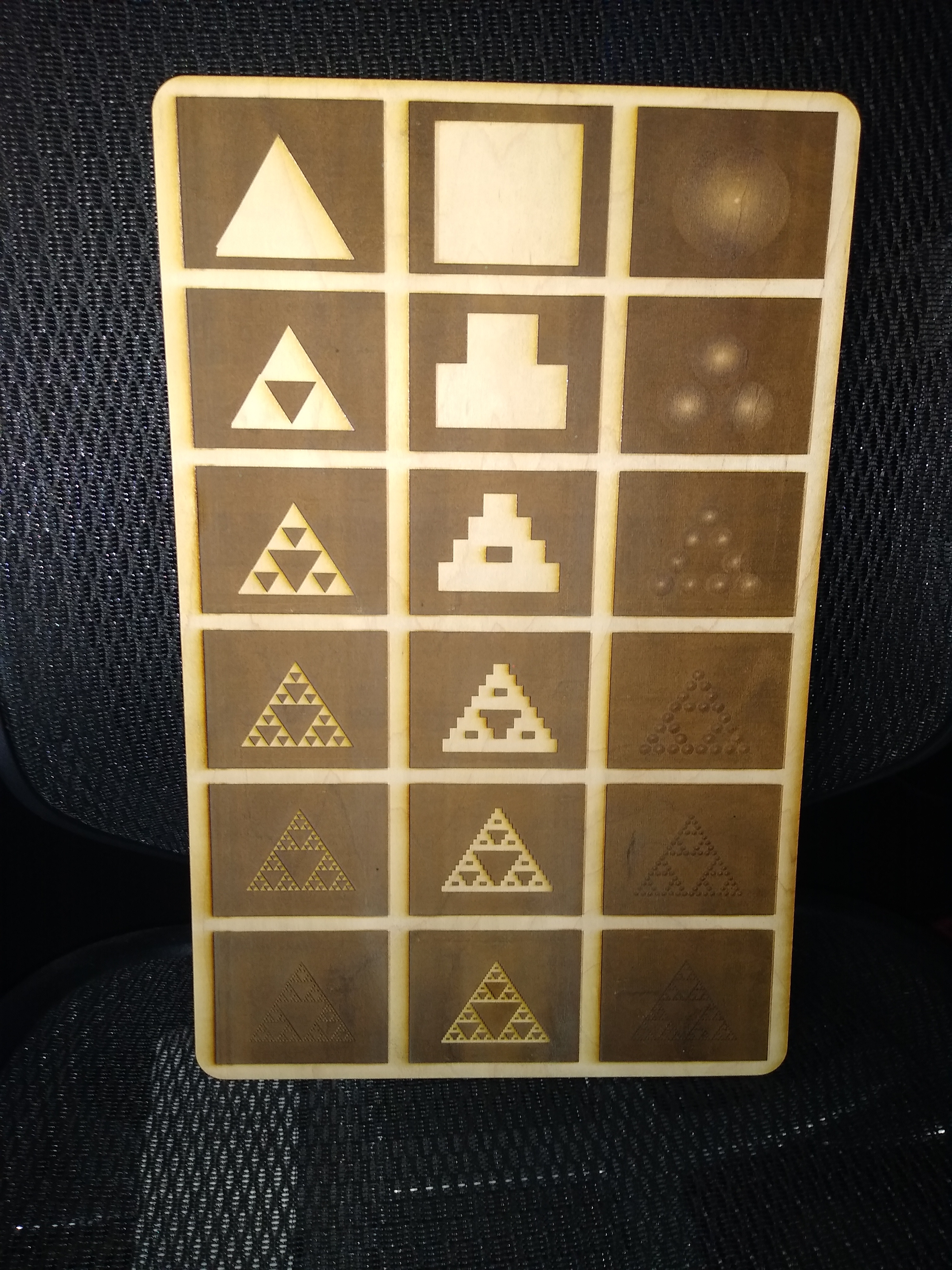 This large panel engraving demonstrates that ANY starting shape will produce a sierpinski gasket when the fractal tiling rules are applied. While the bumps on the left and right don't show very well visually, there's a very distinct texture there.