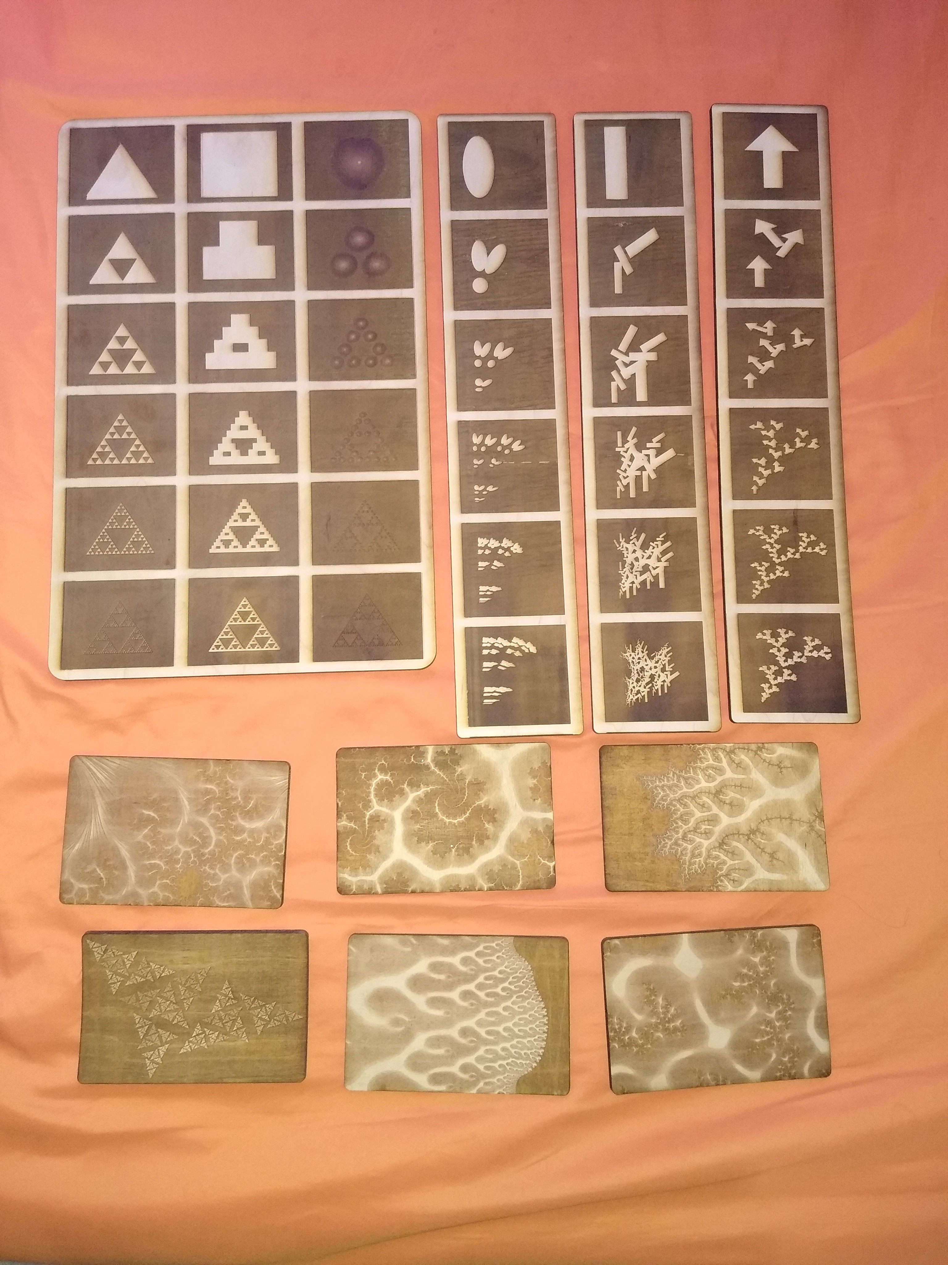 """Finally, the full collection I sent off. All engraved out of 1/4"""" cherry plywood."""