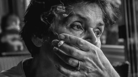 Portrait of a woman smoking cigarette