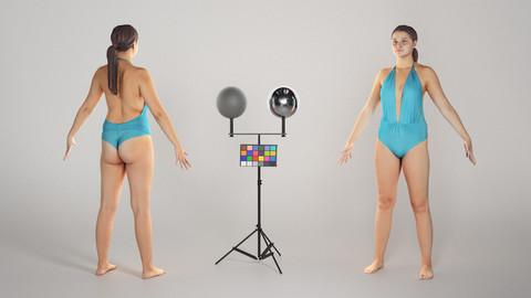 Woman in a blue one-piece plus size swimsuit model 201