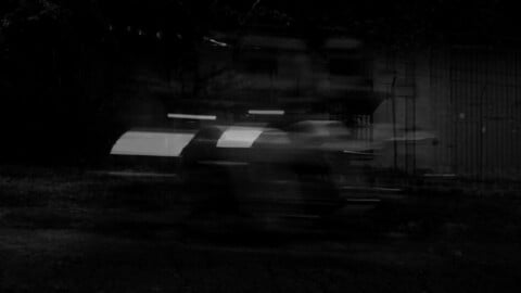 Black and white speed of a car, a motorcycle and a running man.