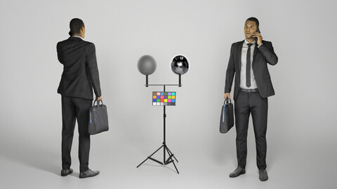 Young businessman with bag talking on mobile phone 283