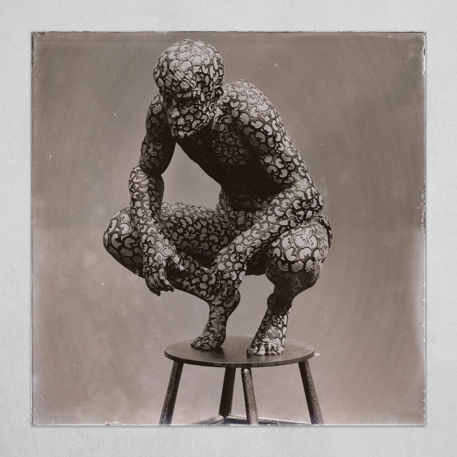 Man crouching B&W